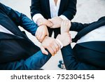 people hand assemble business... | Shutterstock . vector #752304154