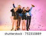 happy stylish friends with... | Shutterstock . vector #752310889