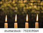 four burning candles on the...   Shutterstock . vector #752319064