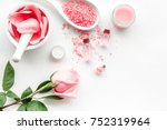 Stock photo make cosmetics with rose oil mortar with rose petals and pestle on white background top view 752319964