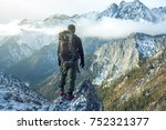 man hiker with a backpack on...   Shutterstock . vector #752321377