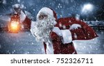 old santa claus with sack of... | Shutterstock . vector #752326711