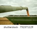 farm trailer being filled with... | Shutterstock . vector #752371129