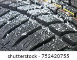 new winter tire covered with... | Shutterstock . vector #752420755