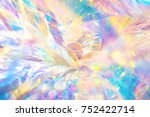 Abstract cheerful fancy festive party background texture of vibrant holographic curly metallic foil ornament with bright shiny crystal gleaming reflections and glittering bokeh light effect
