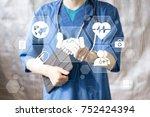 doctor pushing button handshake ... | Shutterstock . vector #752424394