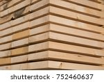 stack of new wooden studs at... | Shutterstock . vector #752460637