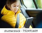 adorable girl sitting in a car... | Shutterstock . vector #752491609