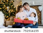 a family of three  in front of... | Shutterstock . vector #752516155