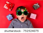 cute boy surrounded by various... | Shutterstock . vector #752524075