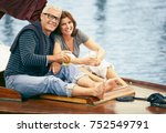 middle aged couple drinking on... | Shutterstock . vector #752549791