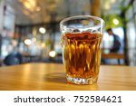 glass cup of tea on old wooden... | Shutterstock . vector #752584621