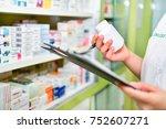 pharmacist filling prescription ...   Shutterstock . vector #752607271
