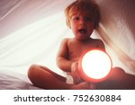 toddler boy in diaper with... | Shutterstock . vector #752630884