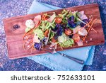 salad on a wooden board with a... | Shutterstock . vector #752633101