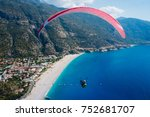 the paraglider flies over the... | Shutterstock . vector #752681707