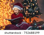 surprised child opening magic... | Shutterstock . vector #752688199