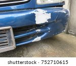 Small photo of Abrasive car color and damaged front bumper