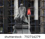 Small photo of 10th of September 2016 - Statue of Fyodor Dostoyevsky and a red Metro sign in fron of the Lenin National Library, Moscow, Russia - hidden by scaffolds