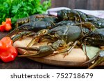 Live Crayfish On A Dark Wooden...