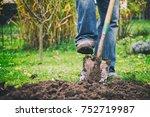 Gardener Digging In A Garden...