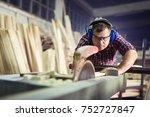 carpenters cutting wooden plank ... | Shutterstock . vector #752727847