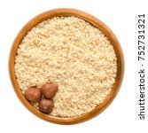 three shelled hazelnuts on... | Shutterstock . vector #752731321