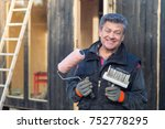 smiling handyman with... | Shutterstock . vector #752778295