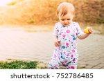 adorable baby girl in sunlight... | Shutterstock . vector #752786485