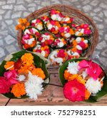 Small photo of Flowers for Ganga Aarti ceremony in Parmarth Niketan ashram at sunset. Rishikesh is World Capital of Yoga, has numerous yoga centres that also attract tourists