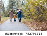 mom dad and a little boy walk... | Shutterstock . vector #752798815