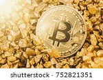 bitcoin with gold nuggets | Shutterstock . vector #752821351