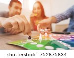 young people play a board game... | Shutterstock . vector #752875834