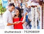 beautiful couple choosing... | Shutterstock . vector #752908009
