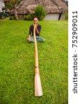 man playing didgeridoo on a... | Shutterstock . vector #752909011