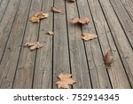 falling leaves on the wooden... | Shutterstock . vector #752914345