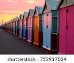 A Line Of 30 Beach Huts With A...