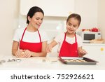 mom and little daughter cook... | Shutterstock . vector #752926621