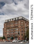 Small photo of Sydney, Australia - March 25, 2017: Historic brown brick Post Office building now converted into Adina Apartment Hotel. Traffice scene with cars and pedestrians near railway stationi.