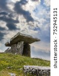"""Small photo of Poulnabrone dolmen, in Irish meaning """"hole of the quern stones"""" is a portal tomb - one of approximately 172 in Ireland - located in the Burren, County Clare, Ireland"""