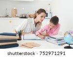 mom helps my daughter do her... | Shutterstock . vector #752971291