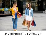 happy girls shopping in late... | Shutterstock . vector #752986789
