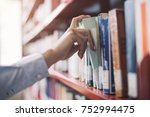 woman at the library  she is... | Shutterstock . vector #752994475