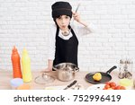 the little boy is mastering the ... | Shutterstock . vector #752996419