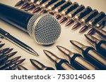 microphone vs. bullets  ... | Shutterstock . vector #753014065