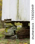 Small photo of Old stacked stone foundation pier with space for text above, vertical aspect