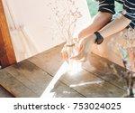 female holding dry flower pot... | Shutterstock . vector #753024025