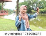 veiled teenager at outdoor park. | Shutterstock . vector #753056347