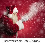 santa claus blowing snow from... | Shutterstock . vector #753073069