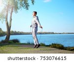 sporty young man jumping rope... | Shutterstock . vector #753076615
